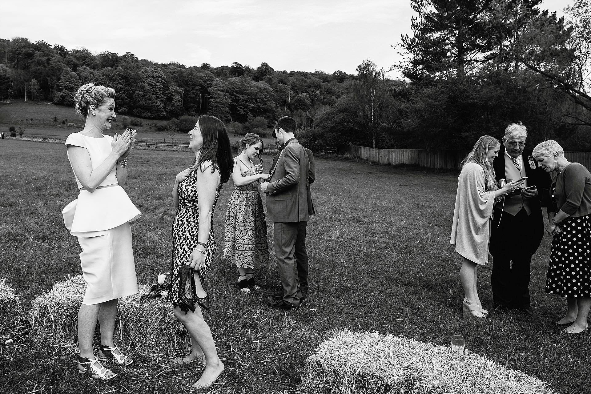 Bride and guests laughing at an outdoor wedding