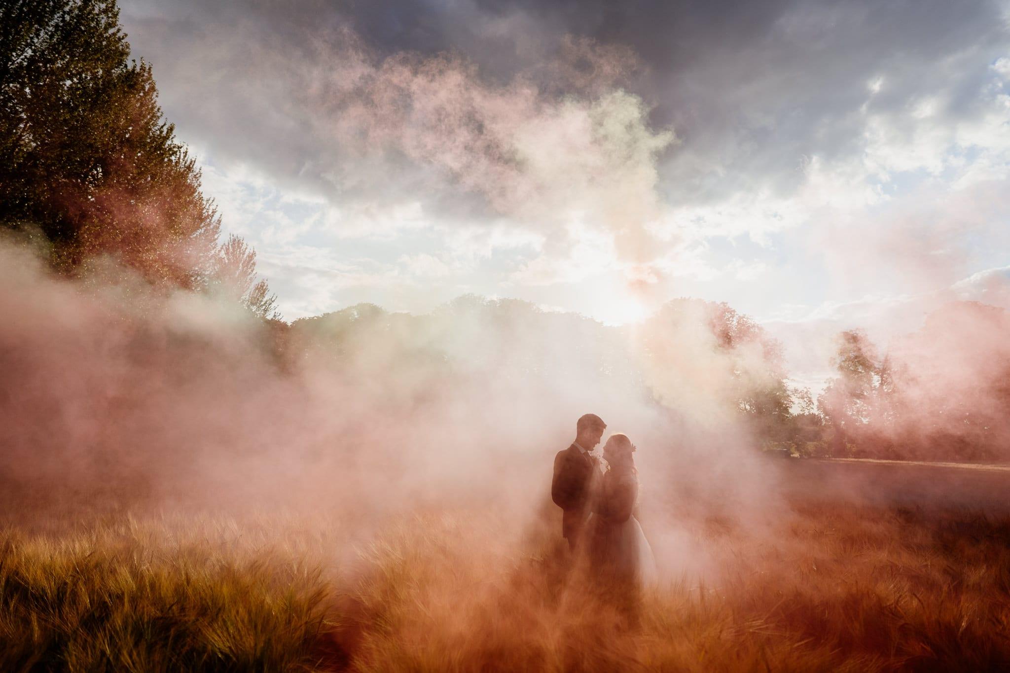 Smokebombs at a wedding. Hertfordshire Wedding Photographer