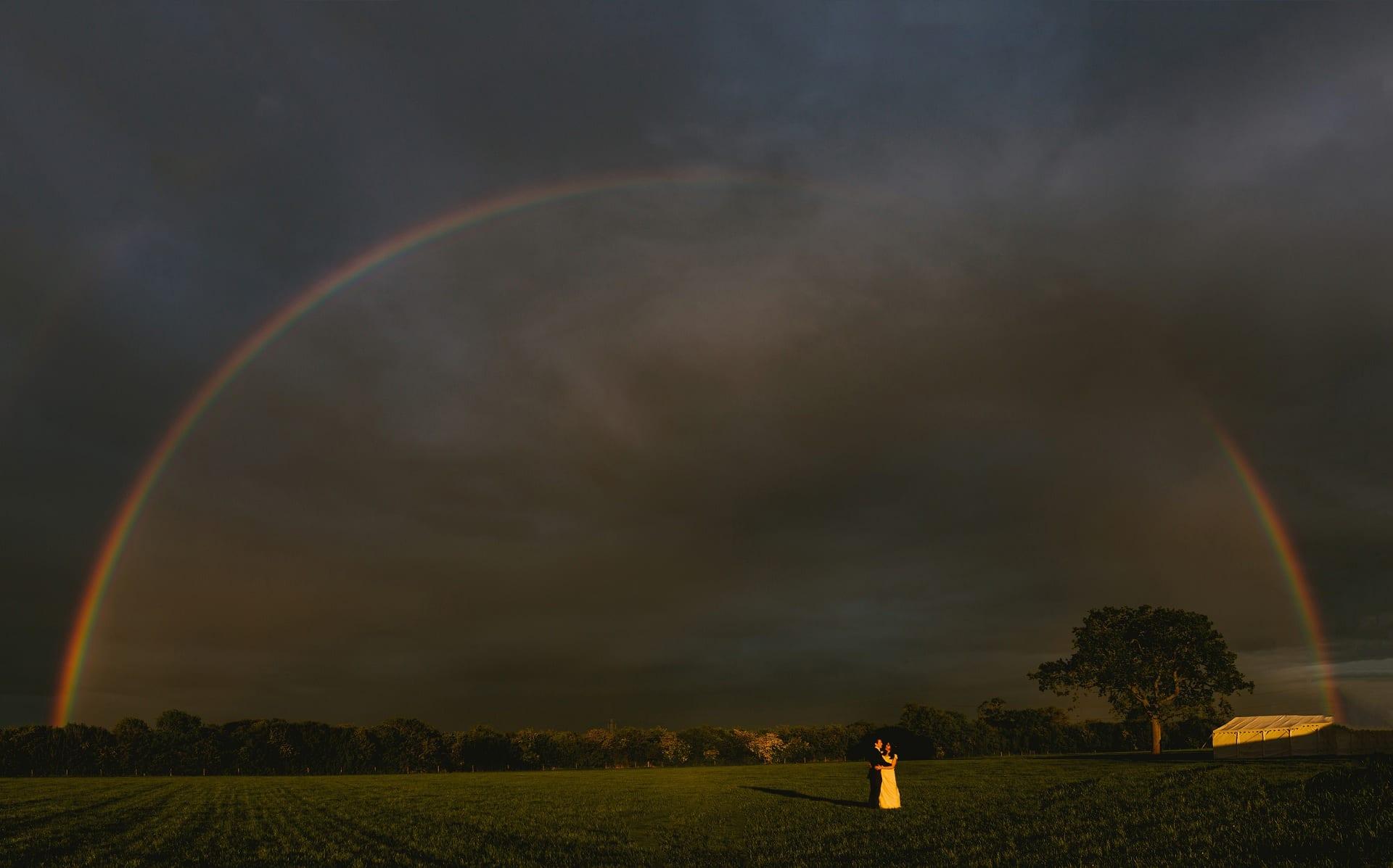 Amazing rainbow over couple on their wedding day