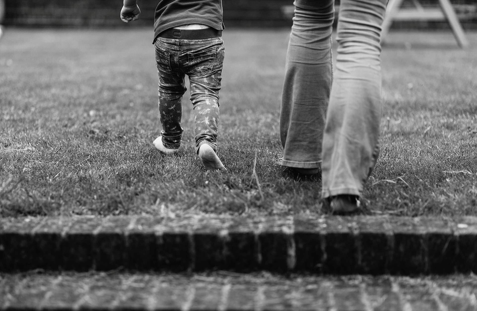Mum and daughter walking away