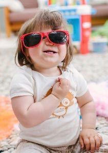 Cute baby with wonky glasses on