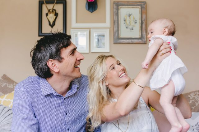 Couple with baby looking very happy