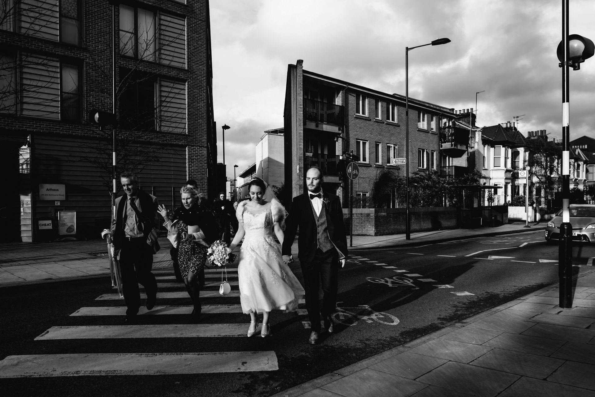 bride and groom walking the street of london