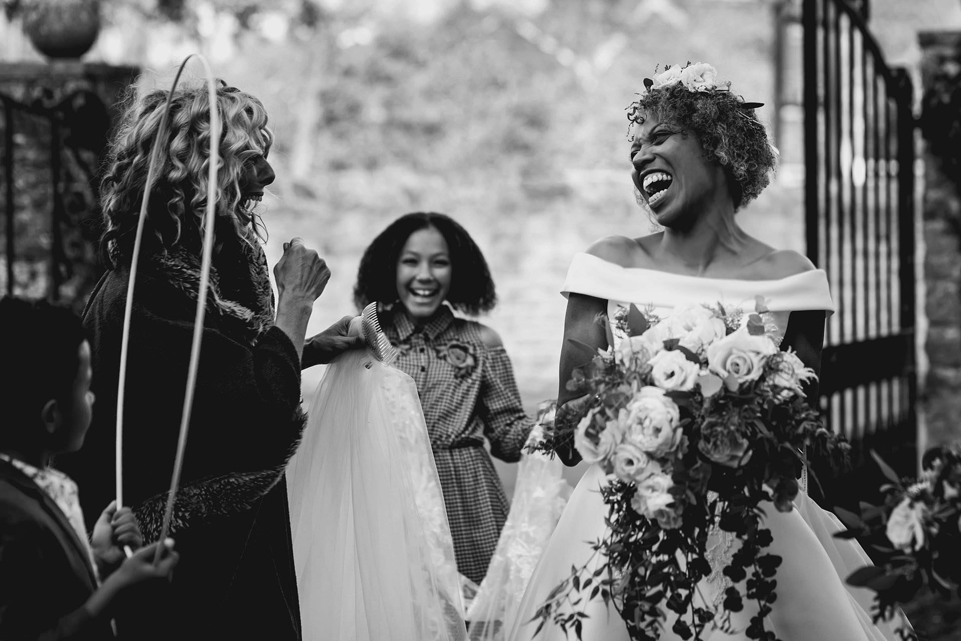 Bride laughing as she loses her hoop from her wedding dress