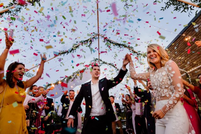 Confetti cannon at roof top wedding in London Wedding photography