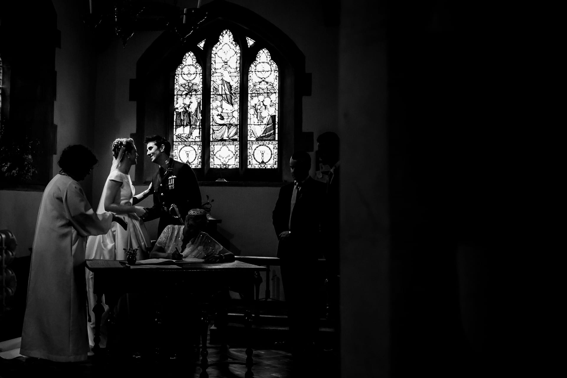 a brief kiss in the church - wedding photography