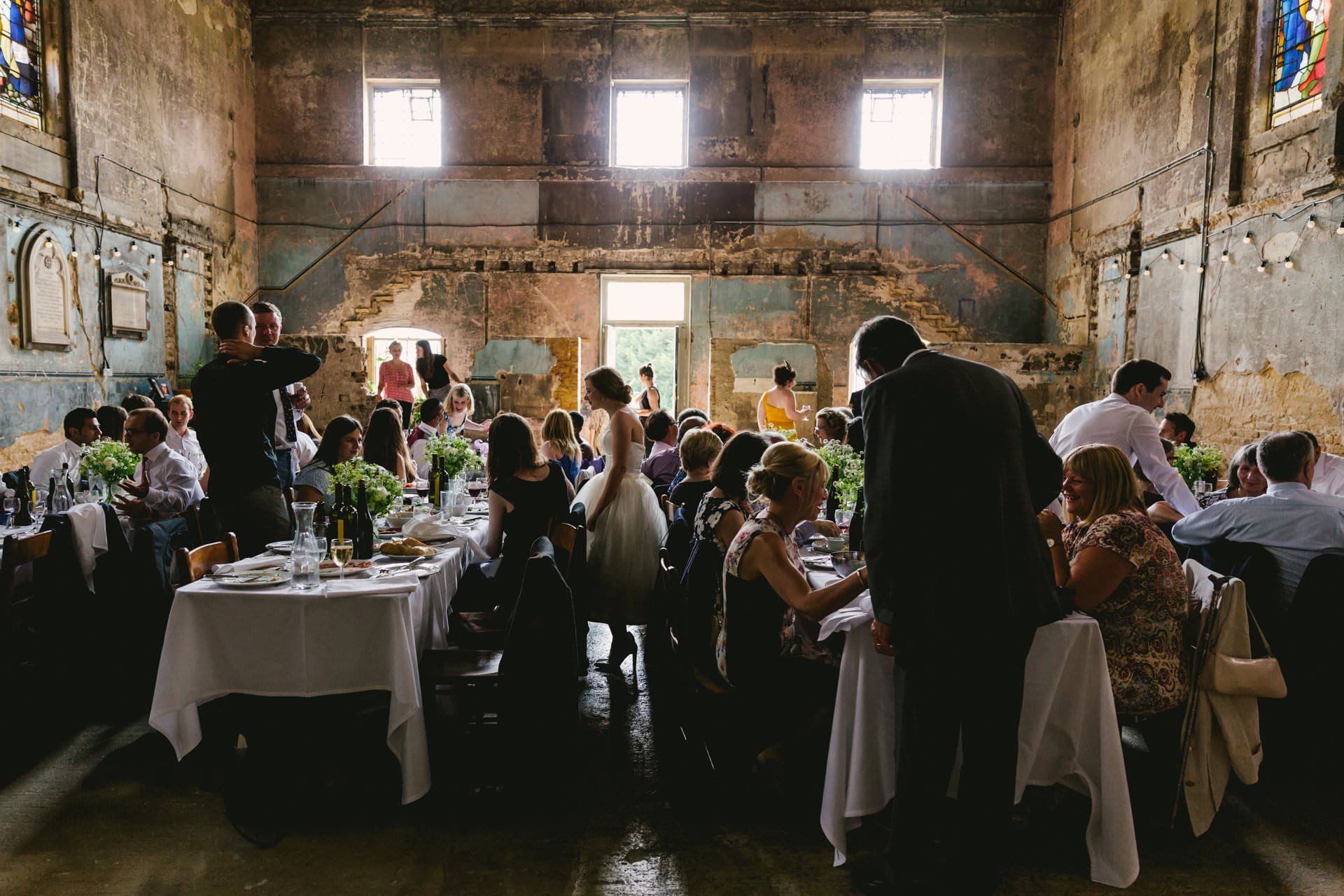 Bride and guests during reception time at the Asylum Chapel