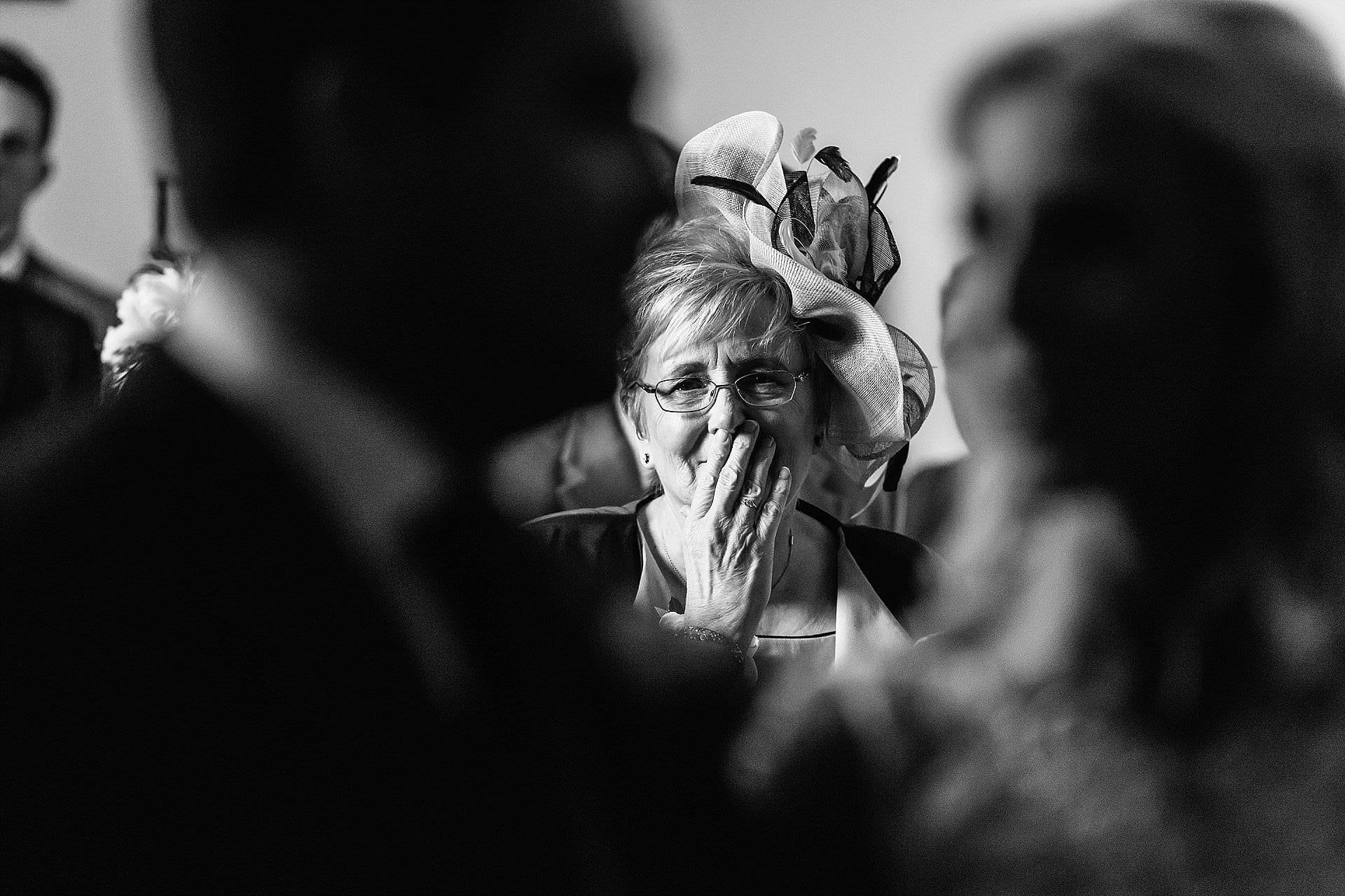 mum looking emotional watching her daughter get married