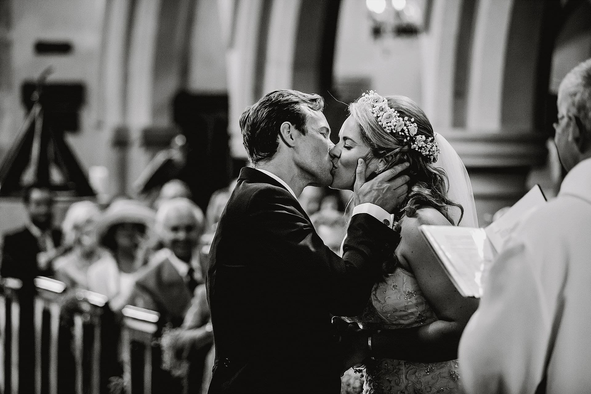 You may kiss the bride - groom grabs his new bride
