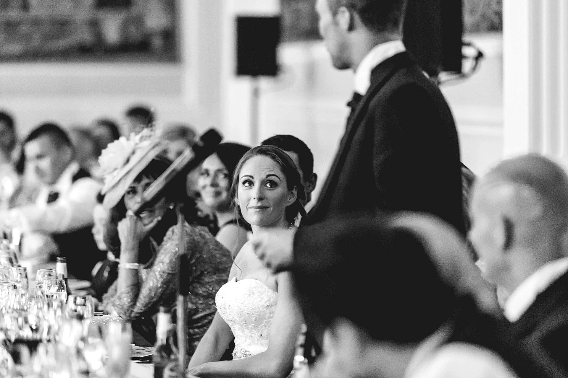 Bride looks at groom during speeches