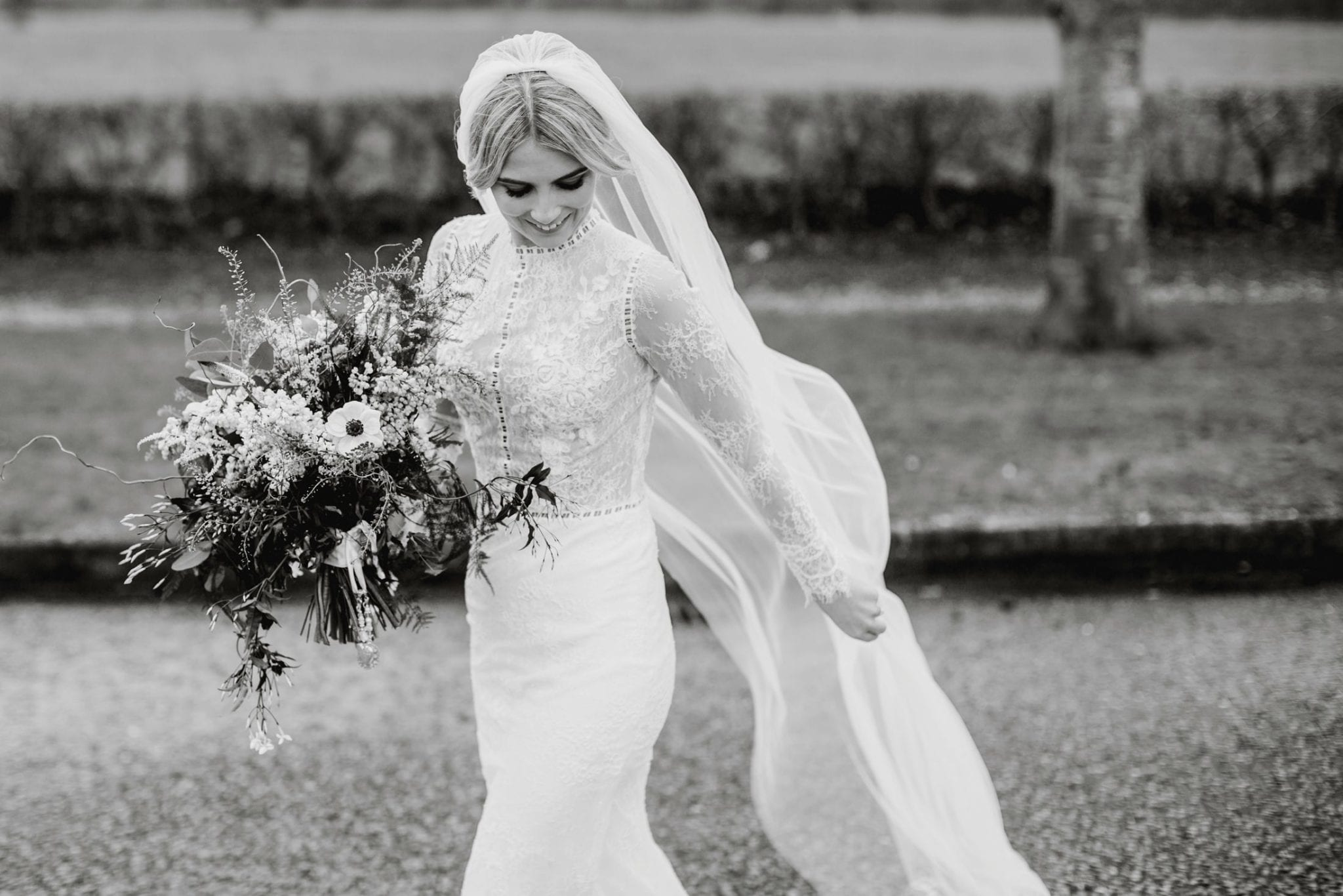 Bride in vintage wedding dress in black and white