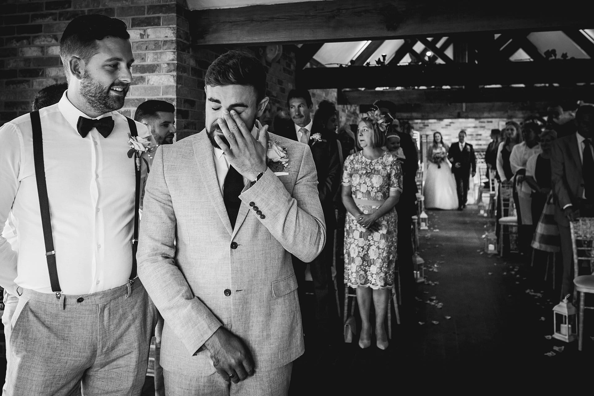 Groom wears away tear as his bride walks down the aisle