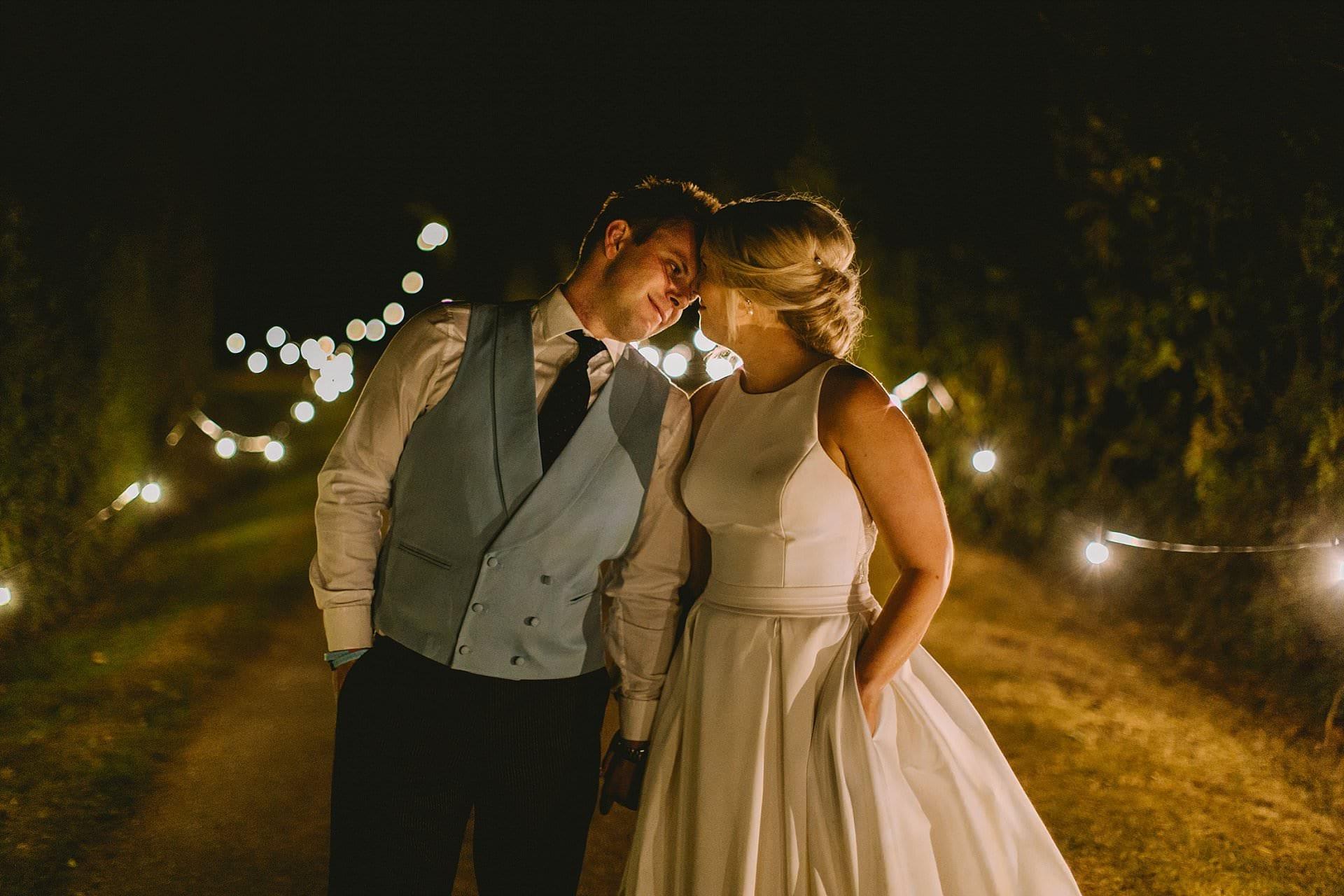Couple kiss at home wedding - at nighttime