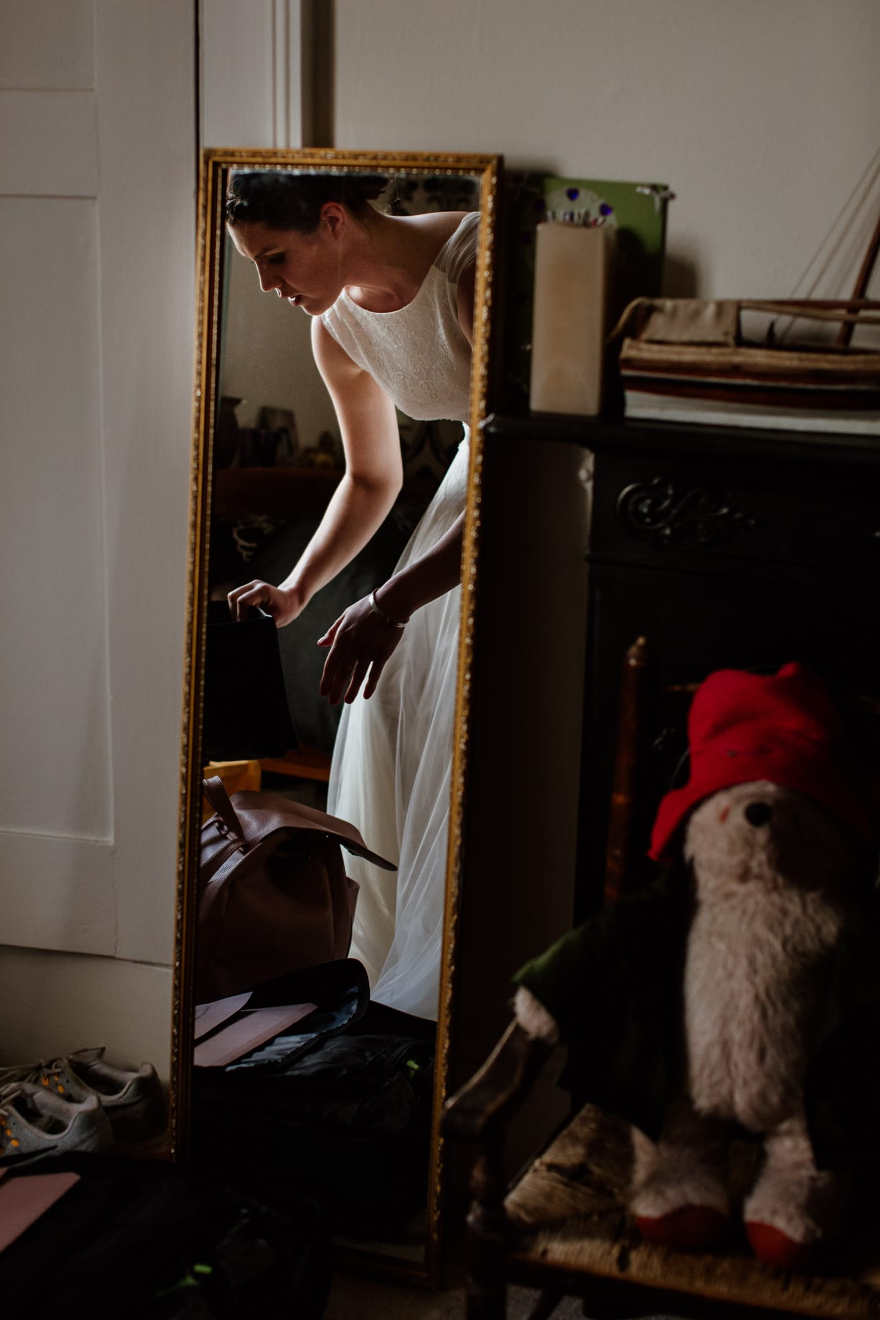 Brides reflection in mirror in her childhood bedroom