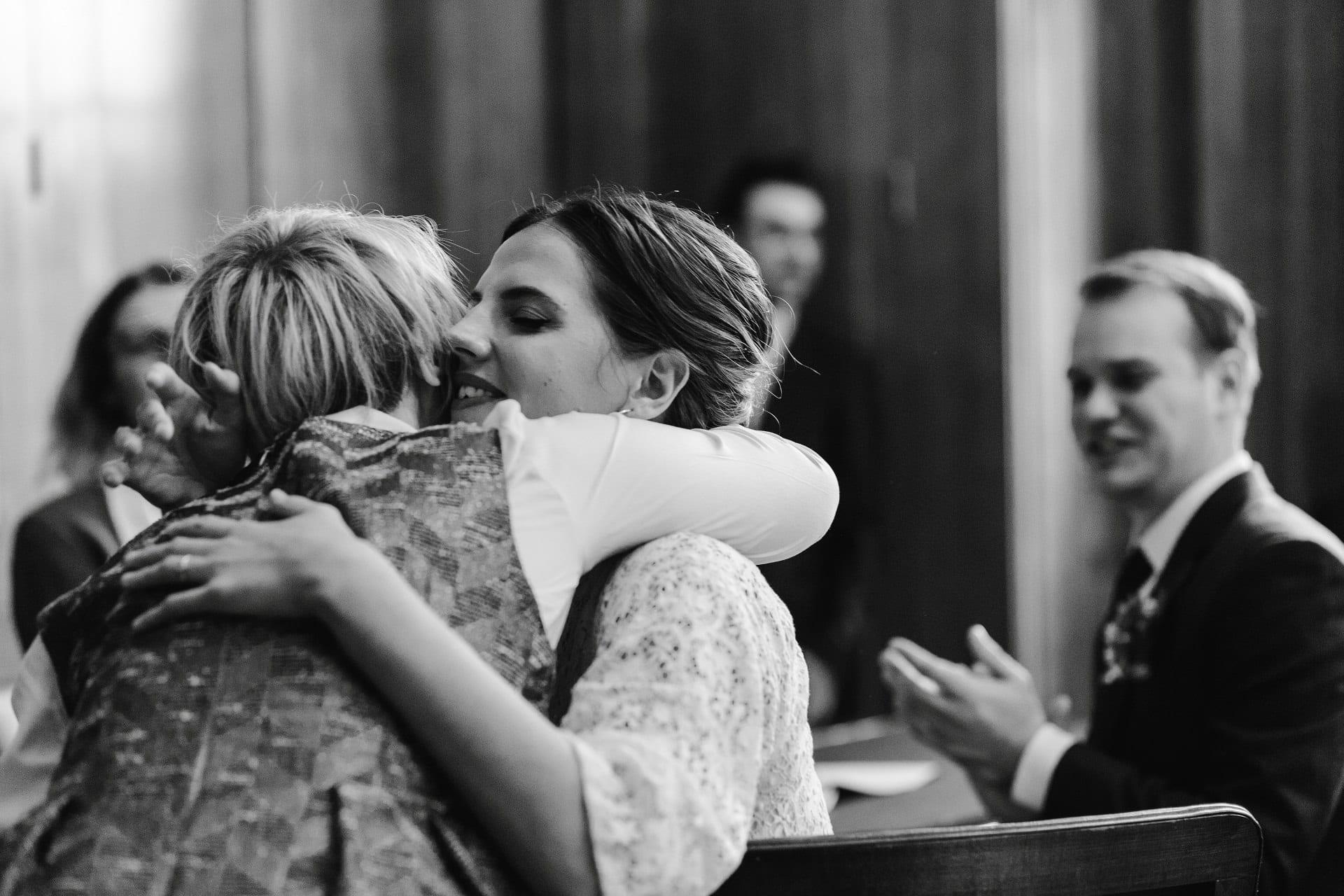 Bride hugs her best man at her wedding