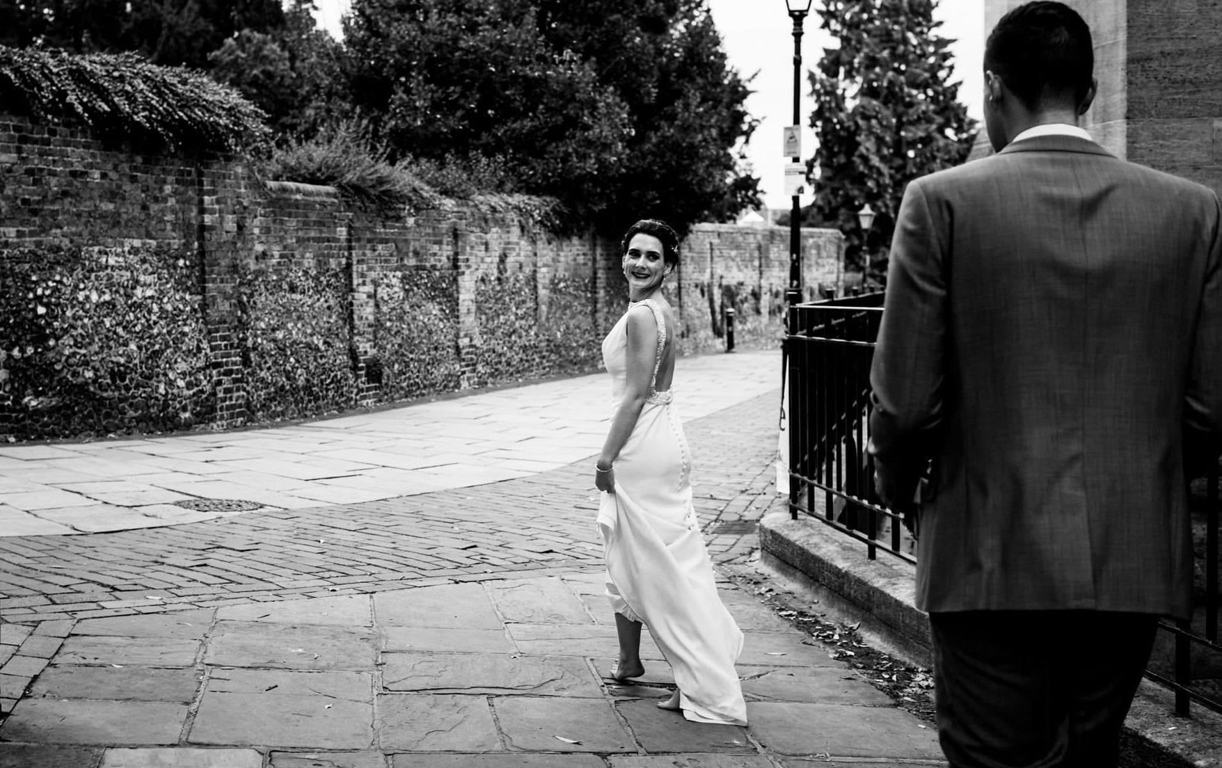 Bride looks back at her new husband in St Albans