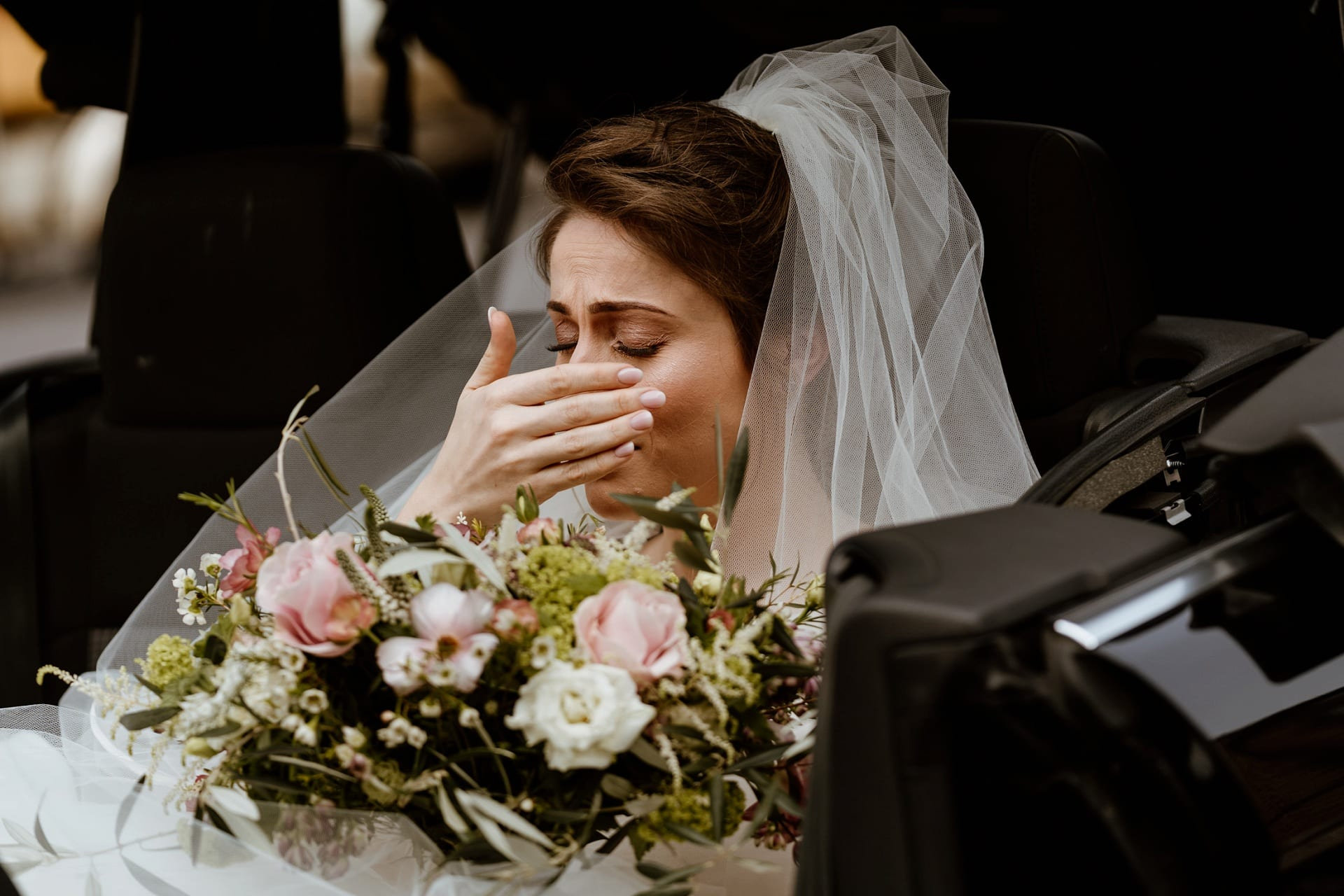 Bride hides a tear as she arrives at church