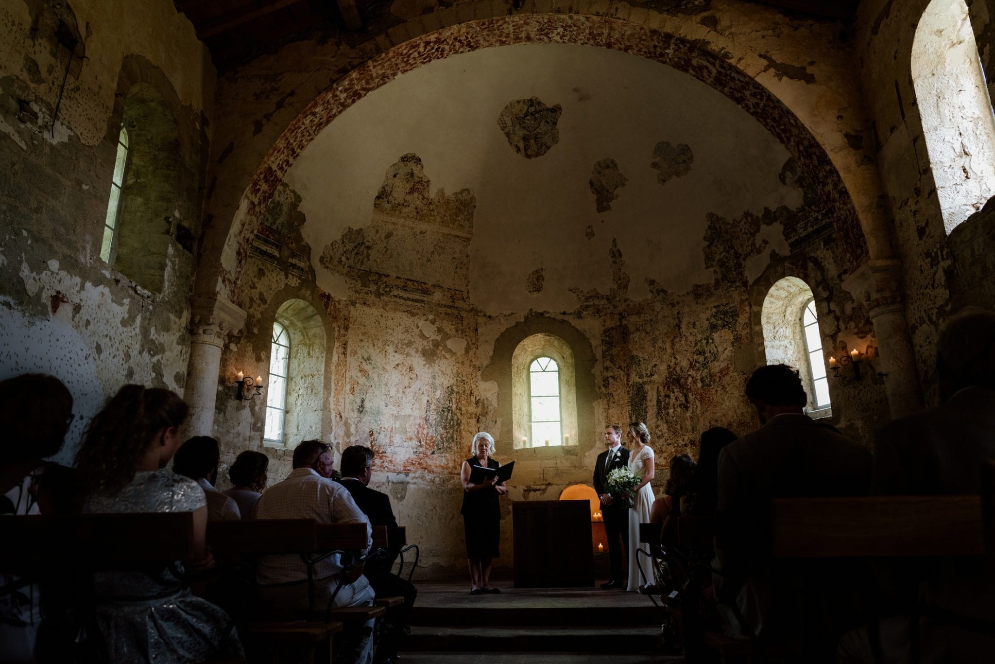 Couple during their wedding vows in French chapel