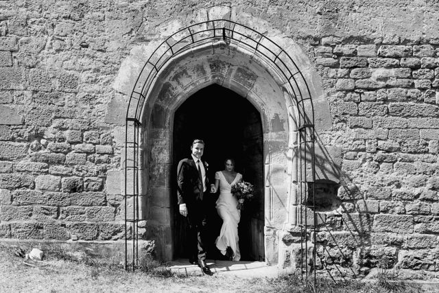 Just married - couple coming out of chapel