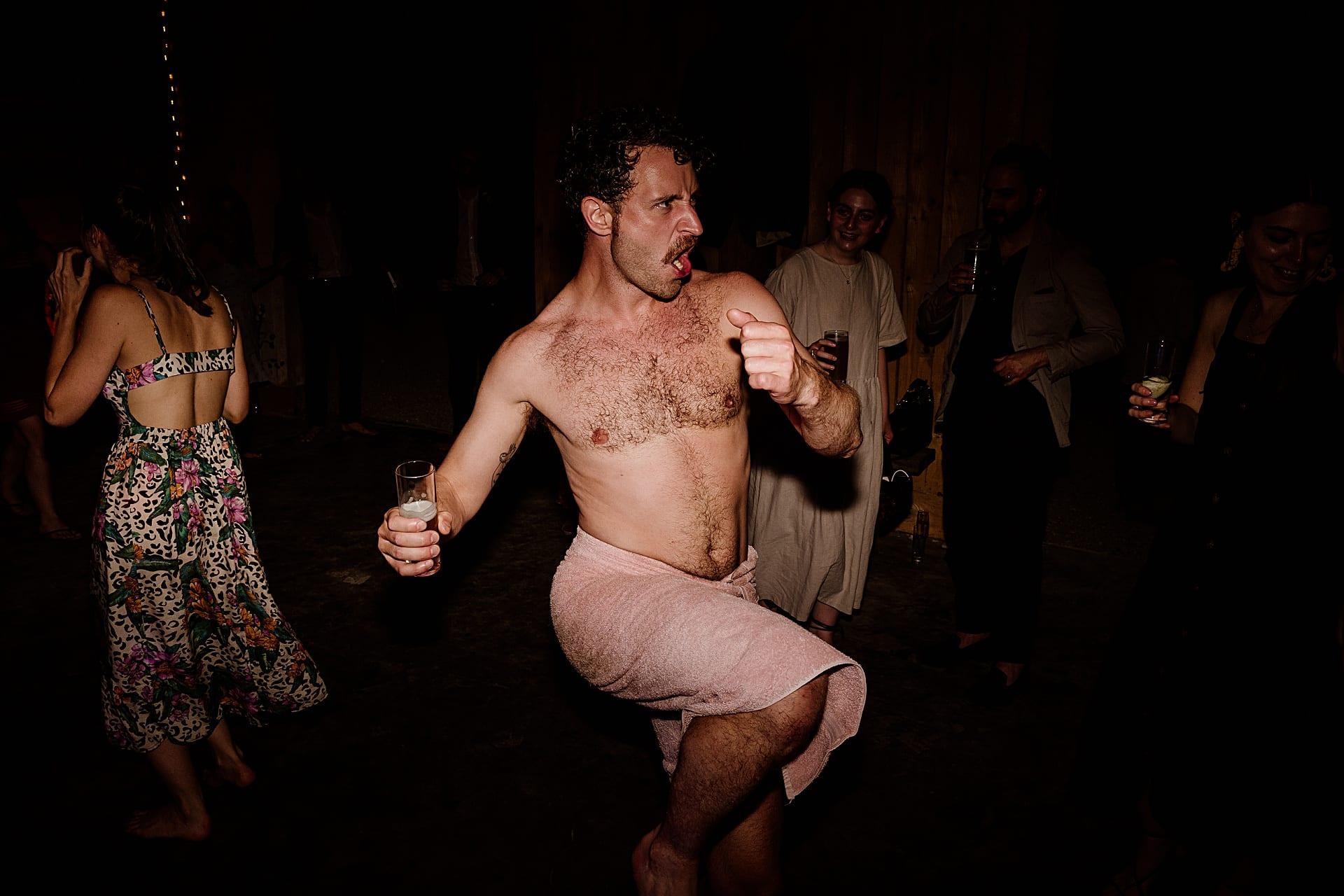 Dancing man in a towel