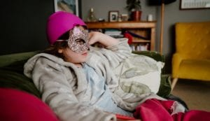 Poorly girl dressed in cat mask and bowl on her head!