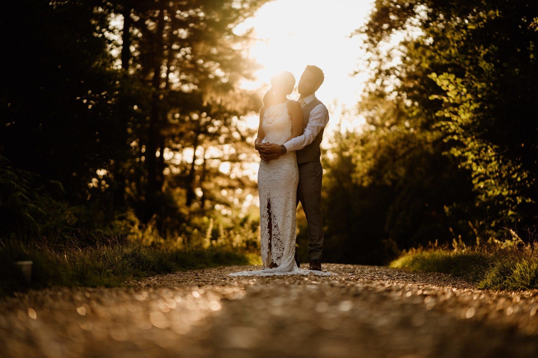 Couple cuddling in the sunshine