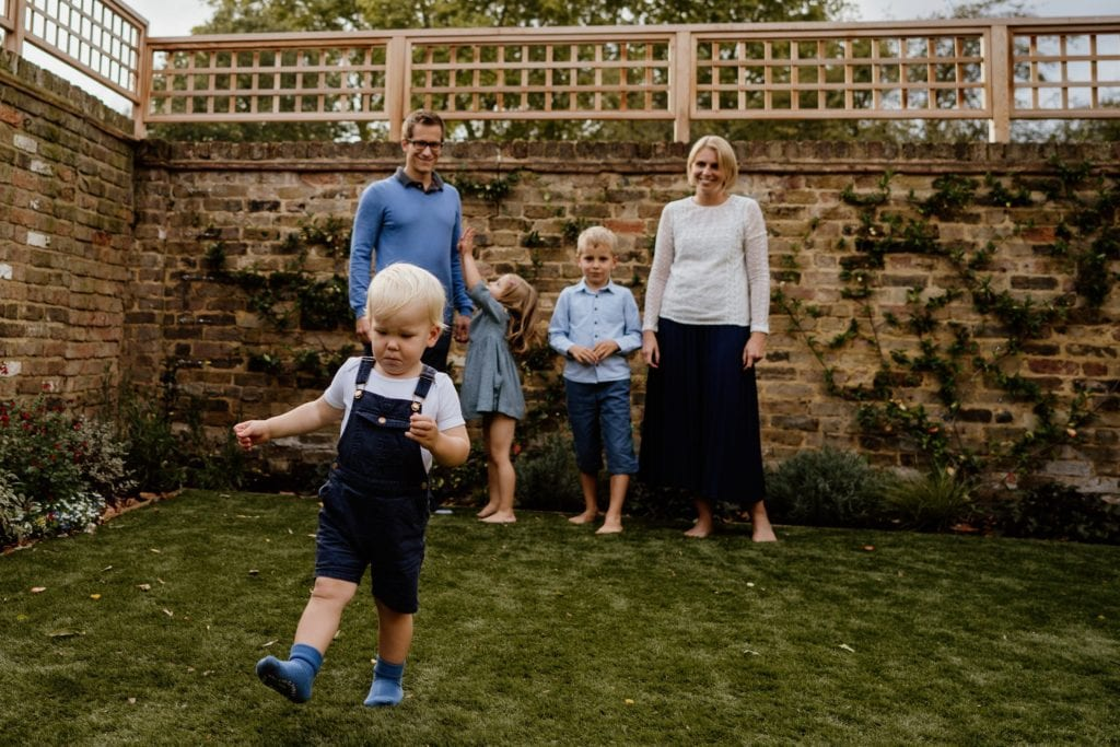Family enjoying playing in the garden