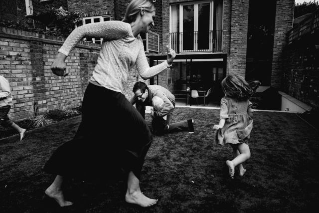 Family enjoying playing in the garden