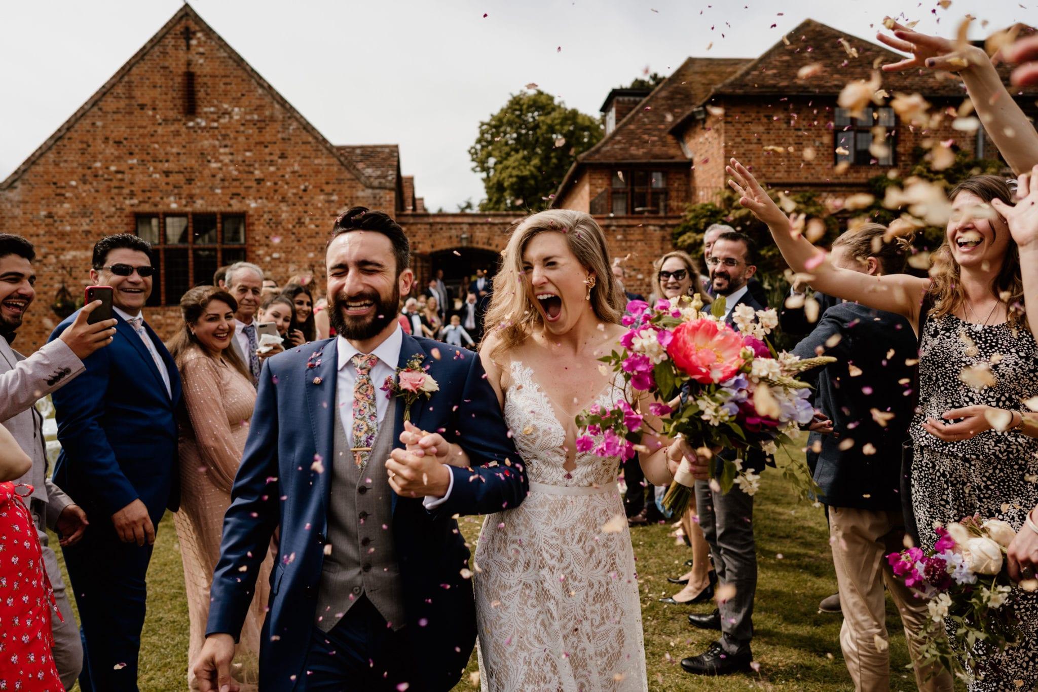 Confetti being thrown at wedding