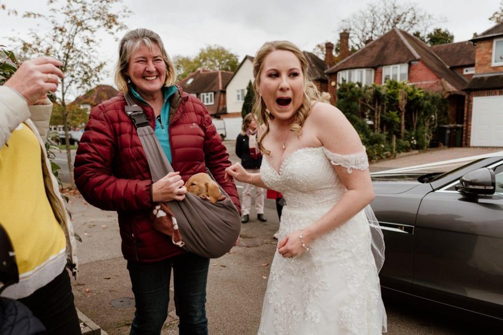 A puppy in a sling genius! Warwickshire wedding